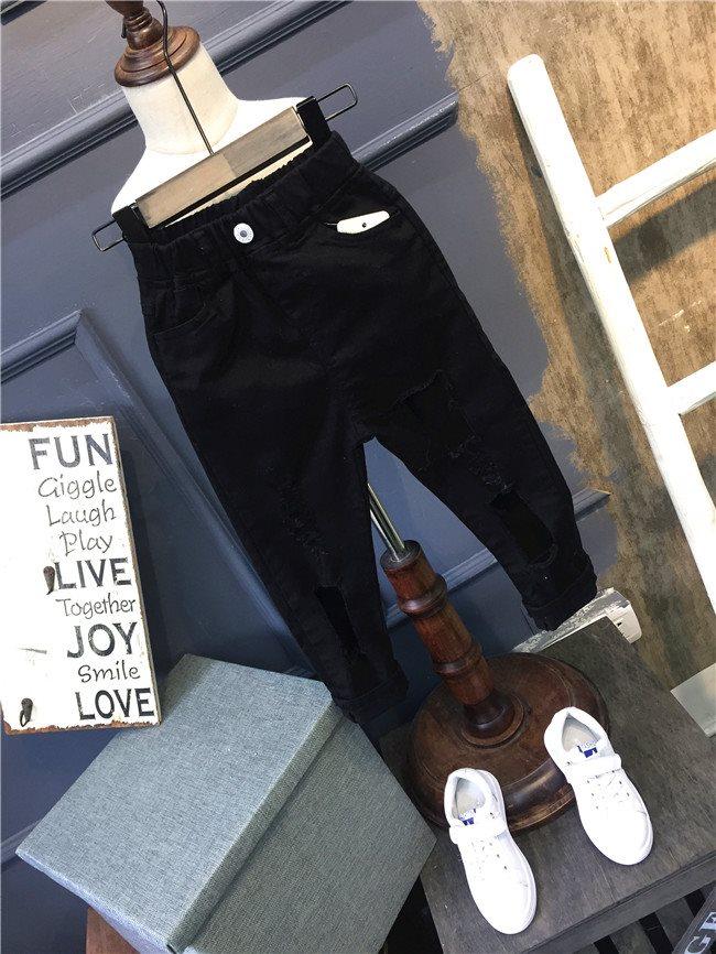 กางเกงขายาวสีดำขาดๆ กางเกงเด็ก